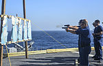 U.S. Sailors fire M9 Beretta pistols during small-arms qualifications June 10, 2013, aboard the guided missile cruiser USS Monterey (CG 61) while underway in the Persian Gulf 130610-N-QL471-580.jpg