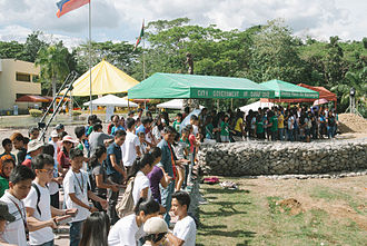 """University of the Philippines Mindanao - Various UP alumni from all UP constituent universities, UP Mindanao administration, staff, faculty, students, and friends of UP participate in the """"Isang Libong Alumni Para Kay Oble"""" Oblation Plaza Construction activity held on 28 February 2015 in line with the 20th Anniversary Celebration of UP Mindanao."""