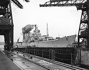 USS Baltimore (CA-68) being reactivated at the Puget Sound Naval Shipyard, in 1951 (NH 98241)