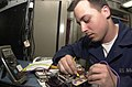 US Navy 020524-N-9483W-006 USS Kitty Hawk - troubleshooting a circuit card.jpg