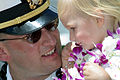 US Navy 021002-N-3228G-004 Navy LT from aboard USS Hopper (DDG 70) smiles at his daughter shortly after the ship's return to Hawaii.jpg