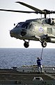 US Navy 021102-N-6213R-003 Attaching a cargo pendant to the bottom of an CH-46.jpg