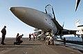 US Navy 030108-N-4953E-002 Aviation Storekeeper 3rd Class Calvin Estes communicates with the pilot of an F-A-18 Hornet during preflight system checks on the ship's flight deck.jpg