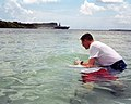 US Navy 030420-N-9236M-025 Chief Electronics Technician Geoffrey Ormston is immersed in the waters of Apra Harbor, Guam by Chaplain Richard Inman during a baptismal ceremony on Easter Sunday.jpg