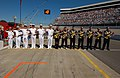 US Navy 031018-N-8629D-117 Members of Navy Recruiting Command and the Navy NASCAR Busch Series Racing Team pit crew honor the national anthem prior to the start of the Sam's Town 250.jpg