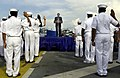 US Navy 040604-F-6655M-049 Sailors aboard the amphibious assault ship USS Essex (LHD 2) raise their right had while repeating the oath of enlistment, during a reenlisted ceremony conducted on the ship's flight deck by the U.S.jpg