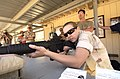 US Navy 040628-N-9288T-100 Photographer's Mate 2nd Class Katrina Beeler, assigned to Fleet Combat Camera Group Pacific, fires an Alexander Arms .50 caliber Beauwolf assault rifle.jpg