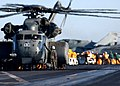 US Navy 041230-N-6363M-009 A MH-53E Sea Dragon helicopter is refueled while personnel unload mail on the flight deck of the Nimitz-class aircraft carrier USS Harry S. Truman (CVN 75).jpg