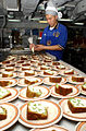 US Navy 050317-N-7405P-089 Culinary Specialist 2nd Class Ho Yoo decorates cakes during preparations for the St. Patrick's Day meal aboard the Nimitz-class aircraft carrier USS Harry S. Truman (CVN 75).jpg