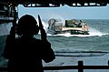 US Navy 050831-N-6204K-001 Boatswain's Mate Seaman Whitney Clark directs a Landing Craft, Air Cushion (LCAC) into the well deck of the amphibious assault ship USS Iwo Jima (LHD 7).jpg