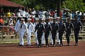 US Navy 050910-N-1332Y-147 Sailors assigned to the guided missile destroyer USS Fitzgerald (DDG 62) march together with local authorities of Pohnpei, Micronesia, as part of a liberation parade.jpg