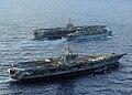 US Navy 051103-N-5345W-071 The Nimitz-class aircraft carrier USS Dwight D. Eisenhower (CVN 69), foreground, sails alongside the Military Sealift Command (MSC) fast combat support ship USNS Arctic (T-AOE 8).jpg
