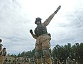 US Navy 060405-N-4097B-006 A Sailor launches a hand grenade during the Navy's Individual Augmentee Combat Training course at Fort Jackson, S.C.jpg