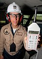 US Navy 061026-N-7981E-019 Lt. Cmdr. Paul Treadway, Industrial Hygiene Officer and Assistant Safety Officer of the Nimitz-class aircraft carrier USS Abraham Lincoln (CVN 72), uses a sound level meter to demonstrate the high deci.jpg