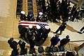US Navy 070102-F-8535W-147 Ceremonial Honor Guard carry the casket of former President Gerald R. Ford into the Gerald R. Ford Museum in Grand Rapids.jpg