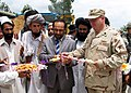 US Navy 070627-N-3385W-001 Commanding Officer of Provincial Reconstruction Team (PRT) Khost, Cmdr. David Adams and the Governor of Khost Province Arsala Jamal break ground for the Matun-Gulzar Road.jpg