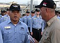 US Navy 070821-N-9162R-225 Storekeeper 1st Class Mamerto Bolado, a chief selectee from USS Ronald Reagan (CVN 76), receives guidance from Ronald Reagan Command Master Chief James DeLozier.jpg