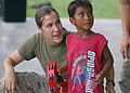 US Navy 070902-N-9421C-085 Cpl. Julia Roberts, of the U.S. Marine Forces Pacific Band, teaches a local youngster how to play the tambourine after a band performance at Uliga Park.jpg