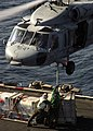 US Navy 071029-N-5928K-007 ailors aboard nuclear-powered aircraft carrier USS Enterprise (CVN 65) attach supplies to the belly of a MH-60S Seahawk.jpg