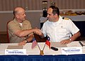 US Navy 071109-N-5677B-005 Capt. Steven Blaisdell, U.S. Naval Forces Southern Command Director of Exercises and Theater Security Cooperation, and Chilean Capt. Francisco Garcia-Huidobro shake hands after signing a memorandum of.jpg