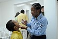 US Navy 080829-N-9774H-043 Hospital Corpsmen 3rd Class Melisa Tracey gives a patient de-worming medication.jpg