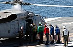 US Navy 100118-N-8822R-041 Sailors load water jugs onto an SH-60F Sea Hawk helicopter to be delivered to Haiti.jpg