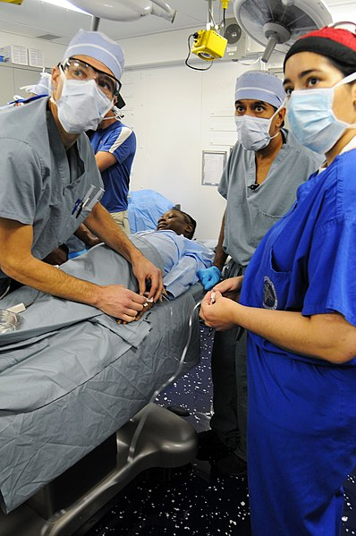 File:US Navy 100118-N-8878B-100 Surgeons perform surgery on a 12-year-old Haitian girl with a severe head injury aboard the Nimitz-class aircraft carrier USS Carl Vinson (CVN 70).jpg