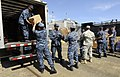 US Navy 100526-N-9643W-280 Sailors assigned to High Speed Vessel Swift (HSV 2) load Project Handclasp donations into vehicles on the pier for several organizations in Panama City, Panama.jpg