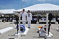 US Navy 100531-N-8433N-251 Capt. Scott Galbreaith, commanding officer of U.S. Naval Base Guam, and Master-at-Arms 1st Class Mandy Holt, salute after placing a wreath on the symbolic gravesite for service members who died in the.jpg