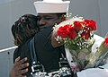 US Navy 100815-N-6764G-190 Engineman 2nd Class Mitchell Roberts embraces his wife after returning to Naval Station Norfolk.jpg