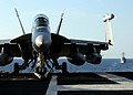 US Navy 101013-N-5446H-041 An EA-18G Growler assigned to Electronic Attack Squadron (VAQ) 141 is on the flight deck of the aircraft carrier USS Geo.jpg
