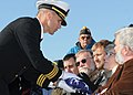 US Navy 101207-N-5812W-005 Cmdr. Craig Bowden, commanding officer of the guided-missile frigate USS Underwood (FFG 36), presents the American flag.jpg