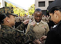 US Navy 101210-N-0208R-079 Hospital Corpsman 3rd Class Crystal C. Cunningham receives her crows from Hospital Corpsman 1st Class Mimi B. Pau, left.jpg