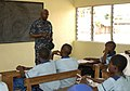US Navy 110407-N-HI707-766 Cmdr. Darryl Brown speaks with students at the Light of Dawn Government Junior Secondary School Tomarow during a communi.jpg