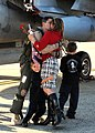 US Navy 111106-N-FJ200-102 A Sailor greets his wife during a homecoming celebration.jpg