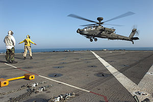 US Navy 120128-N-KS651-244 A Sailor signals a helicopter to land on the flight deck of USS Pearl Harbor.jpg