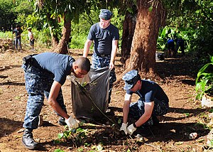 US Navy 120129-N-ET019-849 Sailors gather trash during a Habitat for Humanity community relations project.jpg