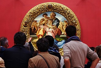 Uffizi - Visitors observing Michelangelo painting Doni Tondo. Uffizi is ranked as the 25th on the most visited art museums in the world, with around 2 million visitors annually.