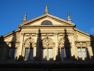 Sheldonian Theatre - Upper portion of the façade, shadowed by the spires of the Bodleian Library