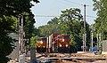 WB Intermodal passing stopped WB Nuclear Train Olathe, KS 8-1-17 (36227726842).jpg