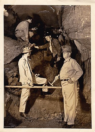 Skyline Caverns - Walter Scott Amos at Skyline Caverns surrounded by workers, 1939