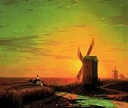 Windmills in the Ukrainian steppe at sunset.jpg