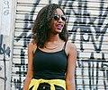 Woman in sunglasses by graffiti in Brazil.jpg