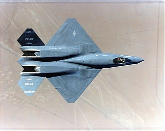 V-tail - A top-down view of the Northrop YF-23 Gray Ghost prototype fighter jet, showing its distinctive wide V-tail and Ruddervators.