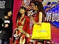 Yua Mikami and IGS hostess on Taiwan Pavilion stage 20180127a.jpg