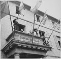 """General Charles de Gaulle speaks to the people of Cherbourg from the balcony of the City Hall during his visit to the F - NARA - 535758.tif"