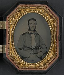 (Unidentified soldier in Confederate uniform with jacket issued to North Carolina troops) (LOC) (14379193677).jpg