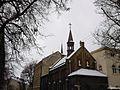 УПЦ КП За будинком та храмом Безсребреників Косми і Дам'яна УГКЦ видніється ракето-подібний купол храму - panoramio.jpg
