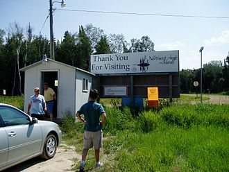 Northwest Angle - Reporting booth at Jim's Corner. Upon entering the Northwest Angle by road, the traveler must enter the booth and report to U.S. Customs via videophone. Before leaving the Northwest Angle by road, one must report to Canadian customs from the same booth.