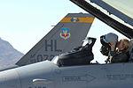 080722-F-0782R-931 Capt. Jennifer Wade, a Female F-16 pilot, dons her flight helmet before taking off during Red Flag 08-3.JPG